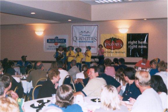 Bob 'Bart' Bardwell and family performing at the Quad City Marathon Expo