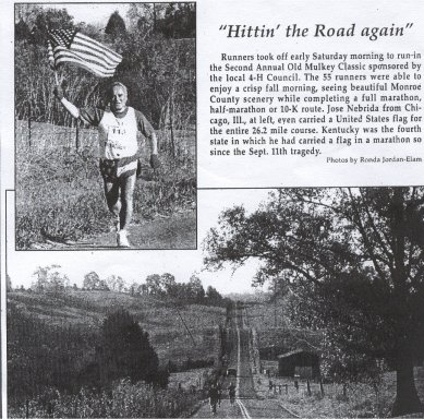 Jose Nebrida running the Second Annual Old Mulkey Classic ,KY 4th marathon he's done carrying the US Flag.