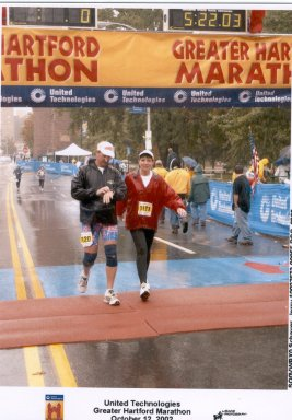 Jerry Schaver & friend Jennifer finishing the Hartford Marathon 10/12/02