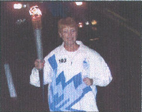 Madonna Bron carrying the Olympic Torch on 01/13/02