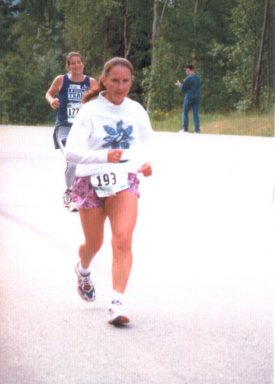 Diane Dubois, running the Mayor's Midnight Sun Marathon in Alaska
