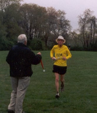 Ira Robinson running towards the finish of the Triple Crown Marathon.