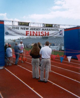 Jarrett Roberts crossing the finish line at the NJ Shore Marathon. 4-27-03