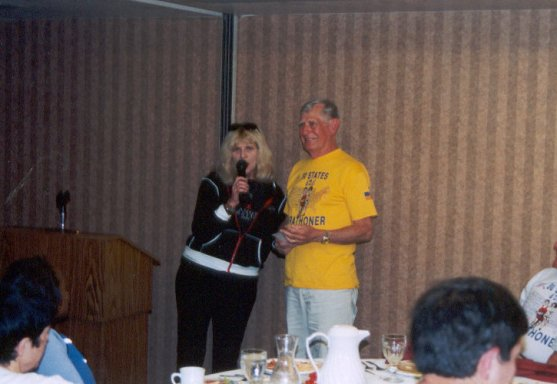 Sharon Kerson with Dean Rademaker at pasta dinner in Deadwood. Sharon presented Dean with a plaque for founding the 50 and DC Marathon Group.