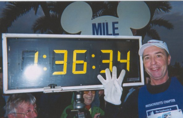 Charlie Nelson stops to pose at the time clock in at Disney Marathon!