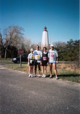 Rose Ann Jolly, Jerry Schaver, Lynda Petri and Jarrett Roberts stops by the lighthouse at the 2003 Jersey Shore Marathon.