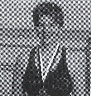 Cheryl L. Murdock with her finisher medal at the Virginia Beach Marathon. 2002