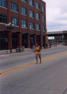 Clara DeCoster finishing the QC Marathon 9/28/03.