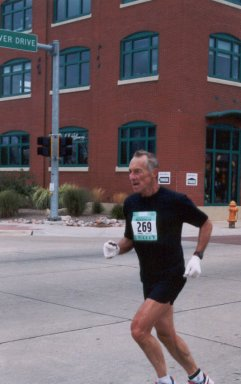Andy Kotulski still running strong at the finish of the QC Marathon on 9/28/03.