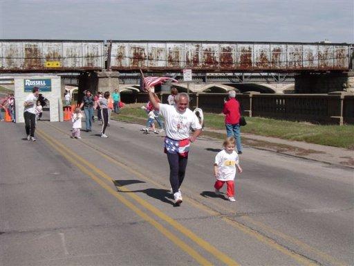 Jose' Nebrida running with the children during there mini marathon.