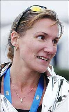 Wendy Hall from Georgia talking to the Atlanta newspaper after winning the Atlanta Marathon. 11/27/03