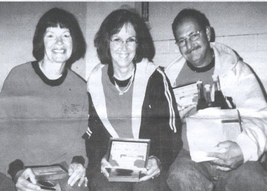 Sanda and Dale Zanchi (in middle and right of photo) completed their 100th marathon at the Walker North Marathon in Walker, Minnesota on 11/29/03 along with friend Gayle.