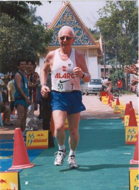 Roger Hauge finishing the Thailand Temple Marathon in March of 2002.