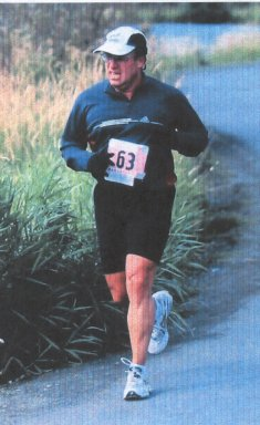 Phil Millard running strong during a marathon.