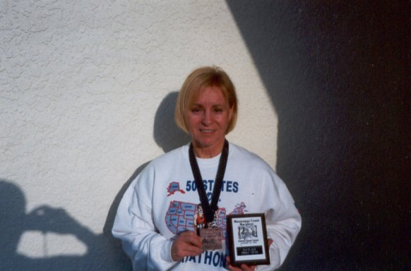 Mieka Gerard with 3rd place age group award at the Mississippi Coast Marathon 2003.