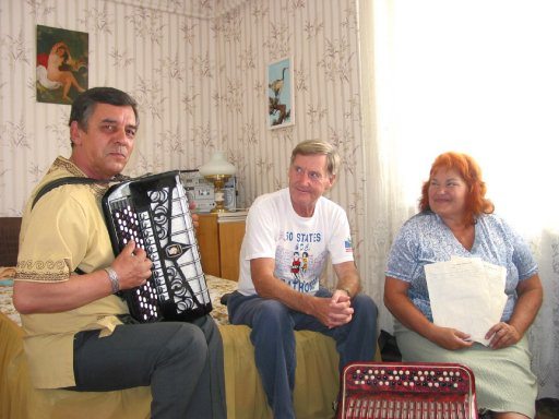 John Wallace was entertained after completeing his marathon in Rivne by some local people.