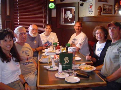 Shirley Pratt, Dean Rademaker, Don McNelly, Jennifer Chrest, Jerry Schaver, Clara DeCoster and Pat DeCoster at the Celebration Dinner after the QC Marathon Sept. 26th, 2004