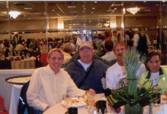 Jay Johnson, Dave Bell, Jerry Schaver, and Jennifer Chrest at the Pasta Dinner in DesMonies 10/16/04.