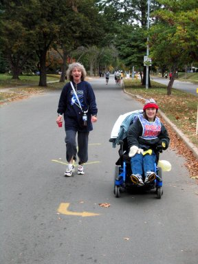 Cathy Troisi and Jamie Barler at the 10 mile mark in the Des Moines Marathon 10/17/04