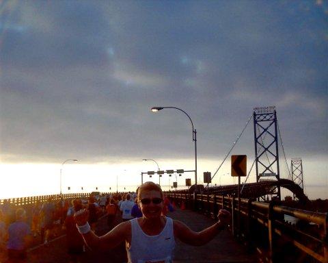 Meta Minton at the Ambassador Bridge crossing in to Canada at Sunrise at the Detroit Marathon 10/24/04