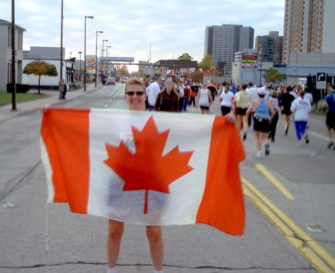 Meta Minton holding the Canadan flag at the Detroit Marathon 10/24/04.