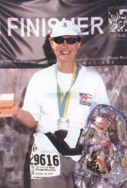 Nita Kay Lemay, Celebrating her 100th Marathon with a beer at the finish line. Chicago, Oct. 2004