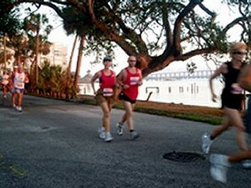 Monica & John Kimbler at the Space Coast Marathon in Florida on 10/28/04. She won 2nd place in her age group 45 to 49 Great job!