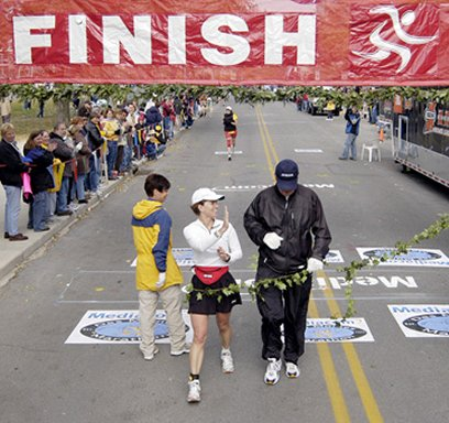 Iowa Governor Tom Vilsak finishing the Des Moines Marathon, October 17, 2004.
