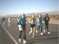 Burt Carlson, a 78 year old member from Minnesota running with some of his fans during the Las Vegas Marathon 1-25-04