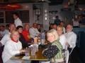 Mieka Gerard, Jerry Schaver, Domitilia dos Santos, Jim Bitgood, Larry Johnson, Karen Desusa, Susan Daly, Bill Brown, Norm Franks, Don McNelly, Jennifer Chrest, and Darcy Mahler at Celebration Dinner after Shamrock Marathon 2004.