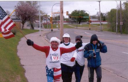 Jose Nebrida, Cathy Troisi, Helene Neville, and Margaret Warfield finishing the Fargo Marathon 5/14/05.