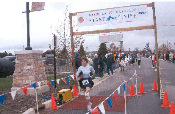 Christine Merriam finishing the Grand Rapids Marathon with the time of 5:07:55 in Oct 30, 2004. Great Job Christine!!!!!