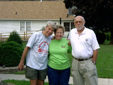 Daniel Sinigallia, Laurie Church, and Don McNelly posing for a picture before going to the Quad City Marathon Expo September 24, 2005