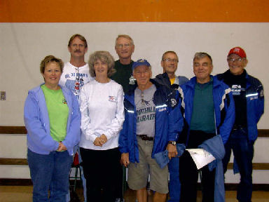 Some of the 50 & DC Marathon Members pose for a picture at the Green Mountain Marathon in South Hero, Vermont on October 15, 2005. Laurie Church, Cathy Troisi, Rick Karampatsos, Henry Rueden Jerry Schaver, Gene Bruckert, Charlie Viers, Richard Freidrichse