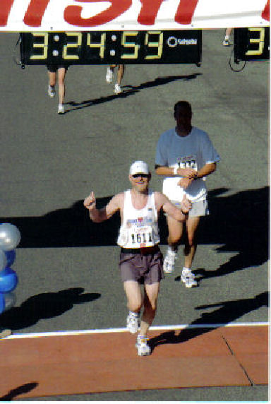 Glendon Riddle crossing the finish line at the St. George Marathon.