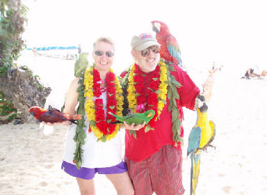 Meta Minton and husband, David, in beautiful Hawaii on the Waikki Beach before the Honolulu Marathon.