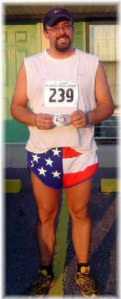 Michael Siltman at the St. Louis Ultra proudly displaying his first 50 mile belt buckle.