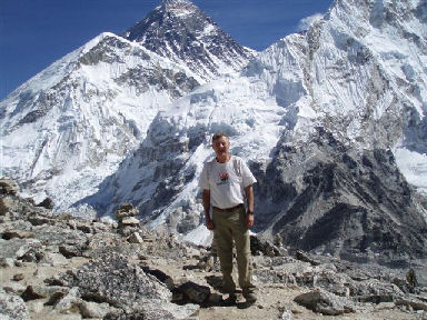 Maddog standing on the summit of Kala Patthar overlooking 'The Top of The World'. It is an awesome but humbling view of Nature since he is standing at 18,555 ft and yet Everest (29,205 ft), Nuptse (25,941) and Lhotse (27,766) still soar more than 10,000 f