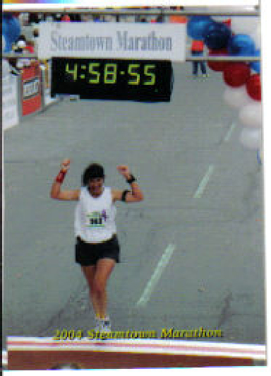 Fran Libasci crossing the Finish Line at the Steamtown Marathon 2004.