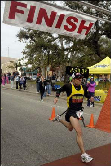 Chuck Engel finishing the Pensacola Marathon 2/19/06 in 2:38:09. He set the course record by 22 minutes. It was also 38 degrees and 14 mph substantial winds. GREAT JOB CHUCK!!!