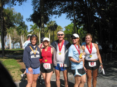 Maddog and some lovely ladies from his 'Running Harem' at the finish line of the Sarasota Marathon.on March 5, 2006. And you thought it was running that keeps him young and fit???