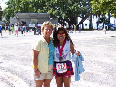 Laurie Church congratulating Boonsom Hartman after completing the Sarasota Marathon 03/05/06.