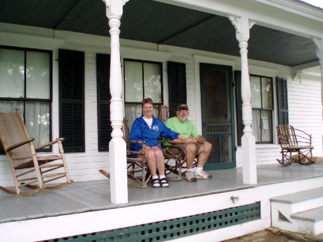Meta Minton and David sitting on the front porch of the birthplace of Calvin Coolidge in Plymouth, Vermont May 2006