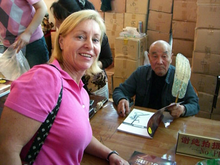 Mieka with Mr. Fong, one of the Farmers who discoverd the pottery Fragments.