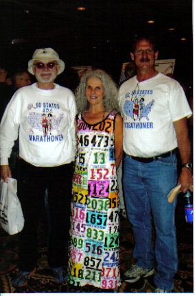 Neil Horton, Maria-Anchorage Marathon Assistant, and Jerry Schaver at the Mayor's Midnight Sun Marathon Expo - 06/17/06.