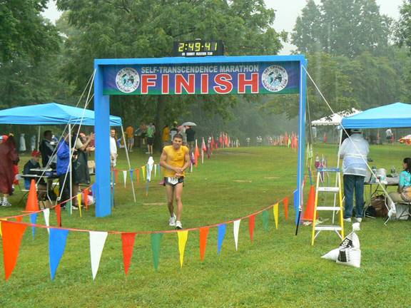 Chuck Engle at thevery wet finish line of the Self-Transcendence Marathon in Nyack, NY 08/06.