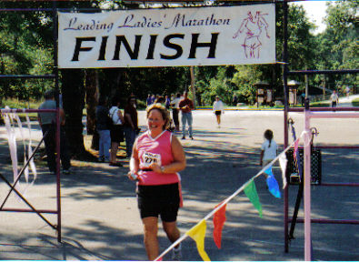Laurie Church finishing her 1st Half Marathon at the Leading Ladies Marathon in Spearfish, SD 08/20/06. What a Great Feeling!