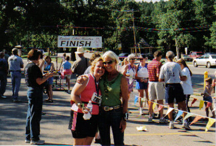 Elaine Doll-Dunn giving Laurie Church a hug after finishing her 1st Half Marathon at the Leading Ladies Marathon in Spearfish, SD 08/20/06.