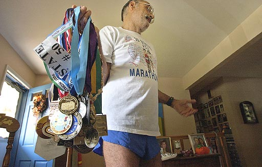 Vincent Ferraro holding all his metals from all 50 States & DC. Vincent is a finisher on 10/01/06.