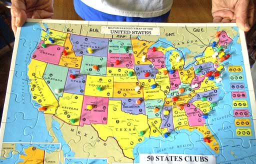 Vincent Ferraro holds his map where he has been of all 50 States & DC and were the cities he has ran at.